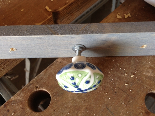 The front should have some space between the knob and the wood. You want to have this gap so that a few necklaces can hang on each knob.