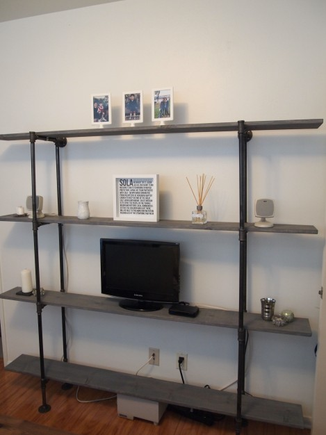 I used some black twist-ties to attach the tv and directTV cables to the back of the pipes. These are our temporary decorations, but you get the idea!