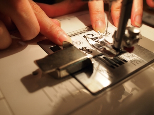 Fara graciously offered to help make tags. We ran them through a sewing machine to perforate them.
