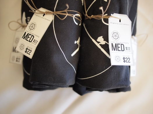 The packaged shirts. I used some hemp-colored thin twine, and rolled them so the chest graphic was displayed.