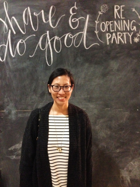 The wifey smiling in front of Share's giant chalkboard backdrop.